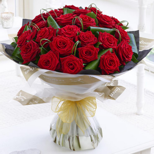 Deluxe 24 Red Naomi Roses Hand-tied
